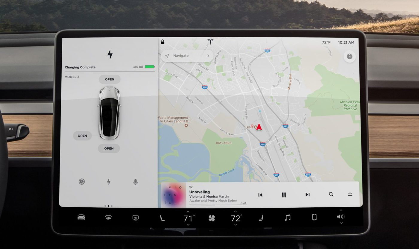 15-inch tablet and head on view of Tesla Model 3 electric car dashboard